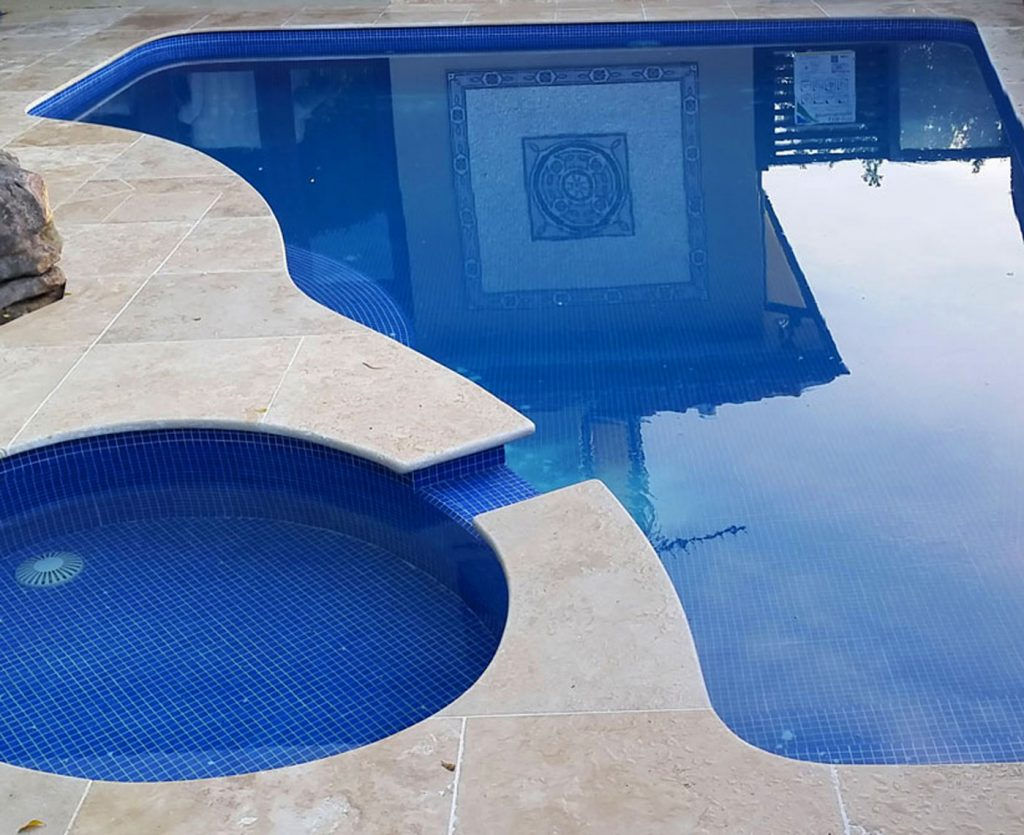 Free-form stone pool coping curves
