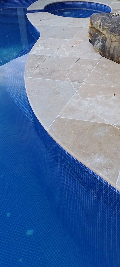 Bullnosed stone pool coping