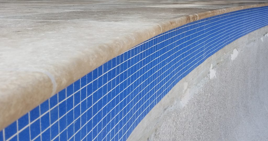 New waterline tiles and bullnose coping