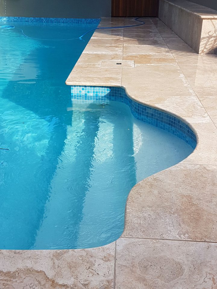 Stone pool coping and surrounds